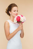 Smiling woman in white dress with bouquet of roses Royalty Free Stock Photography