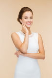 Smiling woman in white dress with diamond ring Stock Photo