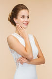 Smiling woman in white dress with diamond ring Stock Photos