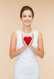 Smiling woman in white dress with red heart Royalty Free Stock Photography
