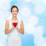 Smiling woman in white dress with red heart Stock Image