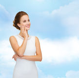 Smiling woman in white dress wearing diamond ring. Holidays, celebration, wedding and people concept - smiling woman in white dress wearing diamond ring over Stock Images