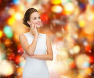 Smiling woman in white dress wearing diamond ring Royalty Free Stock Image