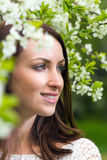 Smiling woman with white flowers Stock Photography