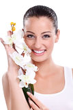 Smiling woman with white orchid Royalty Free Stock Photography