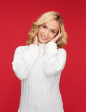 Smiling woman in white sweater Royalty Free Stock Photos
