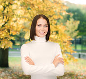 Smiling woman in white sweater Stock Photos
