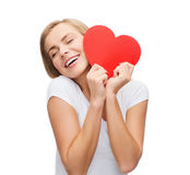 Smiling woman in white t-shirt with heart Stock Photography