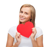 Smiling woman in white t-shirt with heart Royalty Free Stock Image