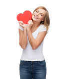 Smiling woman in white t-shirt with heart Royalty Free Stock Photos