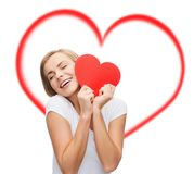Smiling woman in white t-shirt with heart Royalty Free Stock Photo