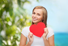 Smiling woman in white t-shirt with heart Royalty Free Stock Images