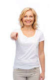 Smiling woman in white t-shirt pointing to you Royalty Free Stock Images