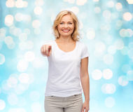 Smiling woman in white t-shirt pointing to you Stock Photography