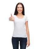 Smiling woman in white t-shirt showing thumbs up Royalty Free Stock Photo