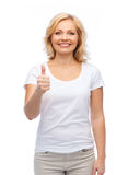 Smiling woman in white t-shirt showing thumbs up. Gesture, advertisement and people concept - smiling woman in blank white t-shirt showing thumbs up Royalty Free Stock Images