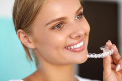 Smiling Woman With White Teeth Holding Teeth Whitening Tray Stock Image