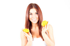 Smiling woman with white teeth holding two halfs of orange. Stock Photography