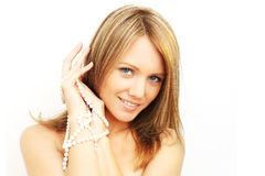 Smiling woman - white teeth and pearls Royalty Free Stock Photography