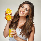 Smiling woman in white undershirt holding fresh juice in glass a. Nd fruit. isolated portrait royalty free stock images