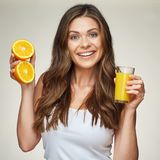 Smiling woman in white undershirt holding fresh juice in glass a. Nd fruit. isolated portrait royalty free stock photos