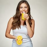 Smiling woman in white undershirt holding fresh juice in glass a. Nd fruit. isolated portrait stock photos