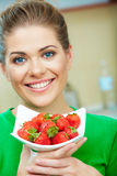 Smiling woman whith strawberry. Stock Images