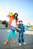 Smiling woman width boy holding color plastic Stock Images