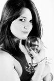 Smiling woman with wineglass. Black and white portrait of smiling young woman with wineglass, isolated on white background Royalty Free Stock Photography