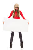 Smiling Woman In Winter Cap Holding Poster Stock Photography