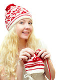 Smiling woman in winter cap knitting patterns Royalty Free Stock Images