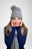 Smiling woman in winter cloth looking at camera Stock Photo