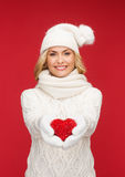 Smiling woman in winter clothes with red heart Stock Photo