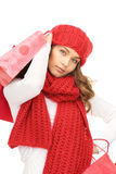 Smiling woman in winter clothes with shopping bags Royalty Free Stock Photos