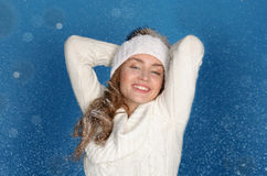 Smiling woman in winter clothes with snow Royalty Free Stock Photos
