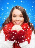 Smiling woman in winter clothes with snowball Stock Images