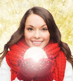 Smiling woman in winter clothes with snowball Stock Photo