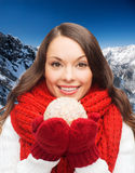 Smiling woman in winter clothes with snowball Stock Photography