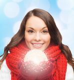 Smiling woman in winter clothes with snowball Royalty Free Stock Images