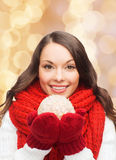 Smiling woman in winter clothes with snowball Stock Photos