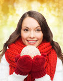 Smiling woman in winter clothes with snowball Stock Image