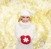 Smiling woman in winter clothes with snowflake Stock Photos