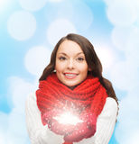 Smiling woman in winter clothes with snowflake Royalty Free Stock Images