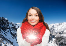 Smiling woman in winter clothes with snowflake Royalty Free Stock Photography