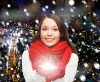 Smiling woman in winter clothes with snowflake Stock Images