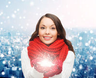 Smiling woman in winter clothes with snowflake Royalty Free Stock Image