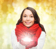 Smiling woman in winter clothes with snowflake Stock Image