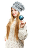 Smiling woman in winter clothing with blue ball Royalty Free Stock Image