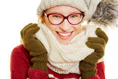 Smiling woman with winter clothing Stock Images