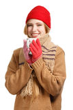 Smiling woman in winter clothing with cup Royalty Free Stock Image